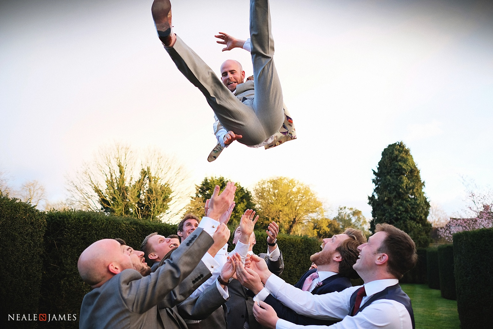 A groom being thrown in the air at Great Fosters