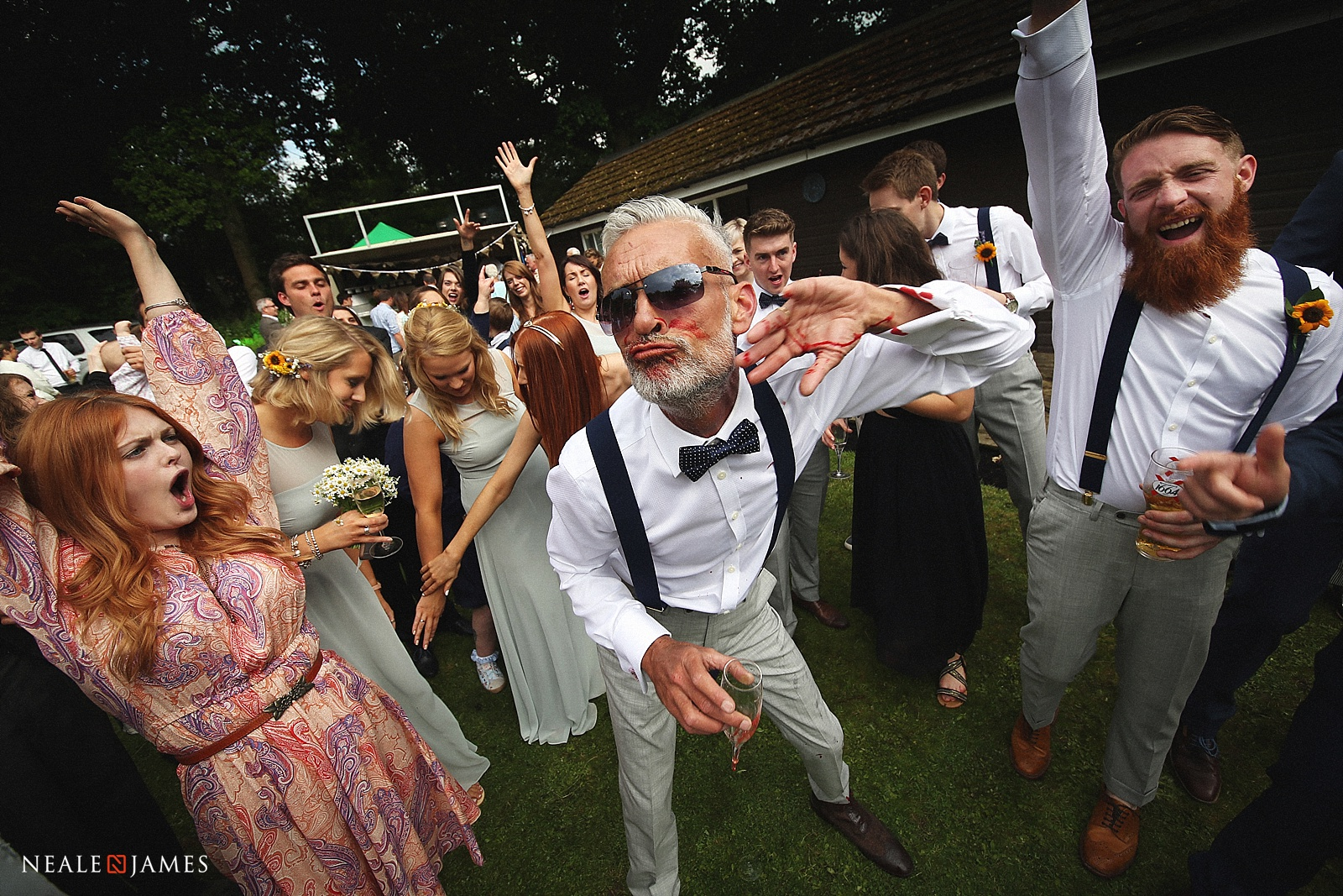 Father at wedding dancing