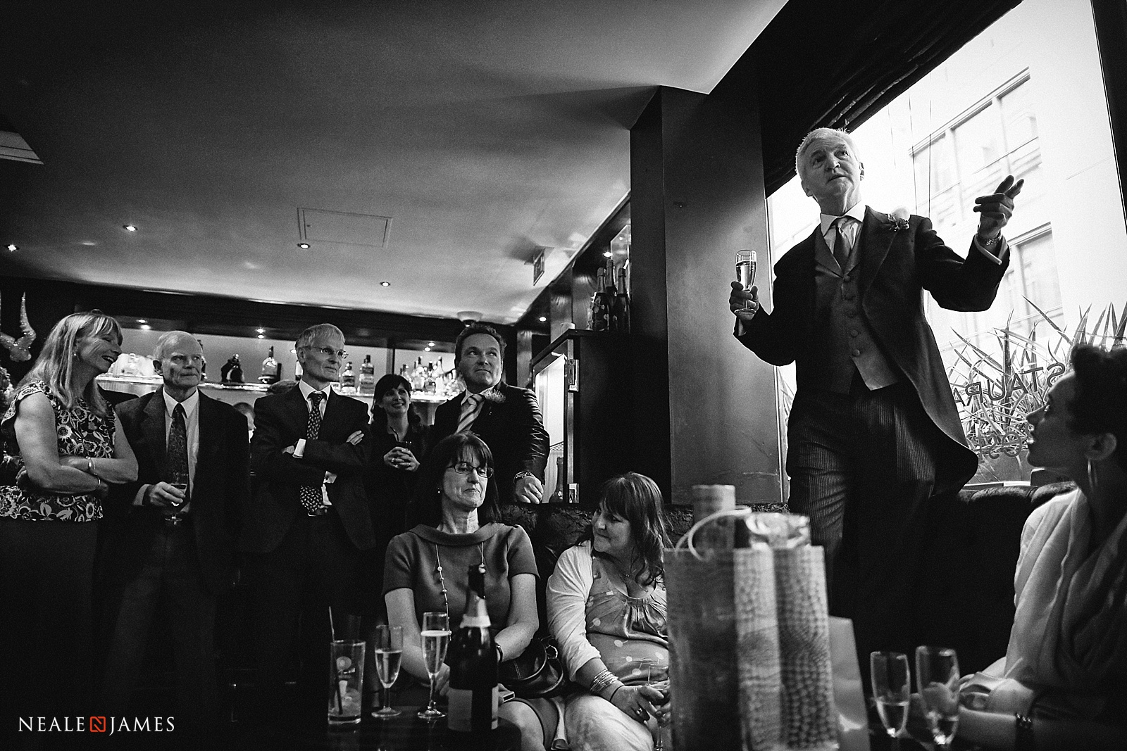 Black and white picture of father making wedding speech in London