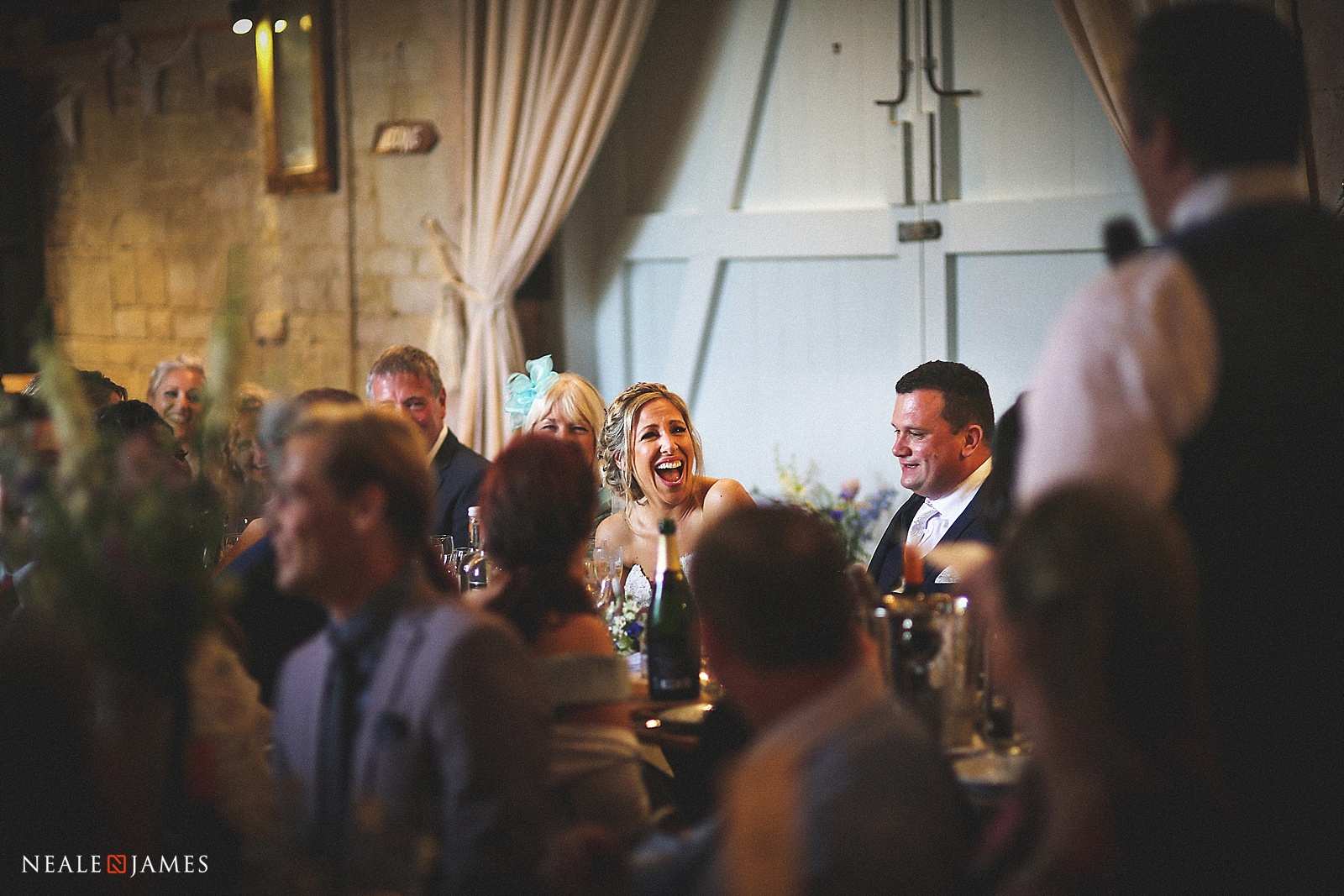Picture of guests laughing during a wedding speech