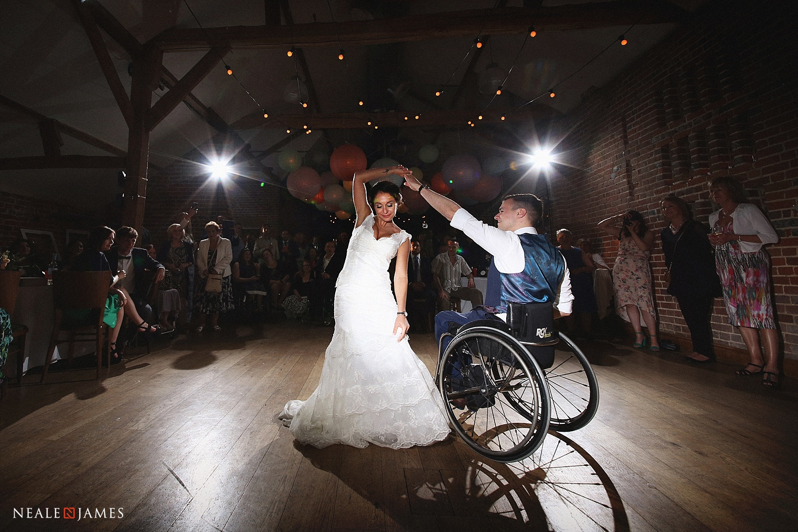 Colour picture of Matt Sealy and wife Shen dancing during their wedding at Wasing Park