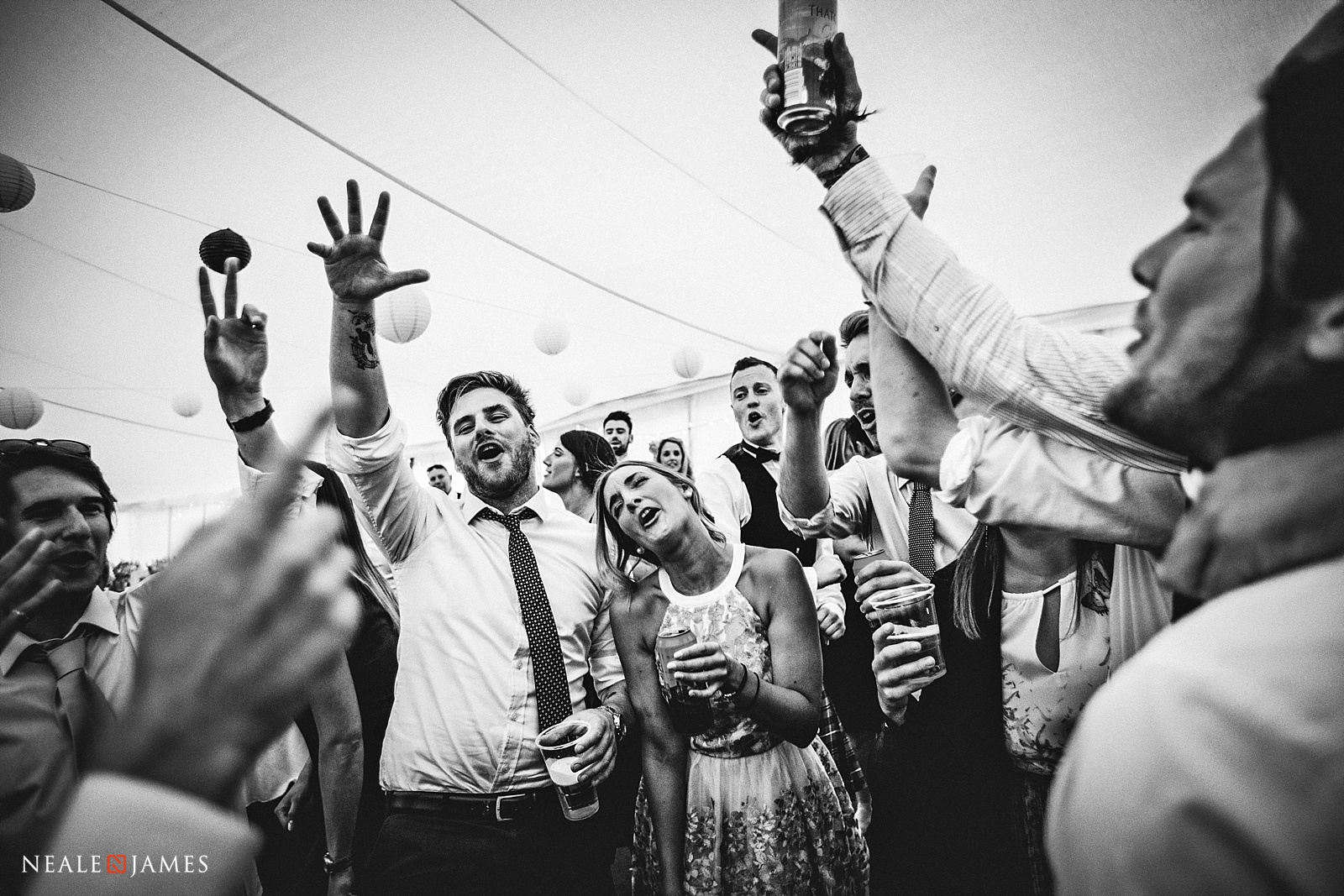 Guests dancing with their glasses
