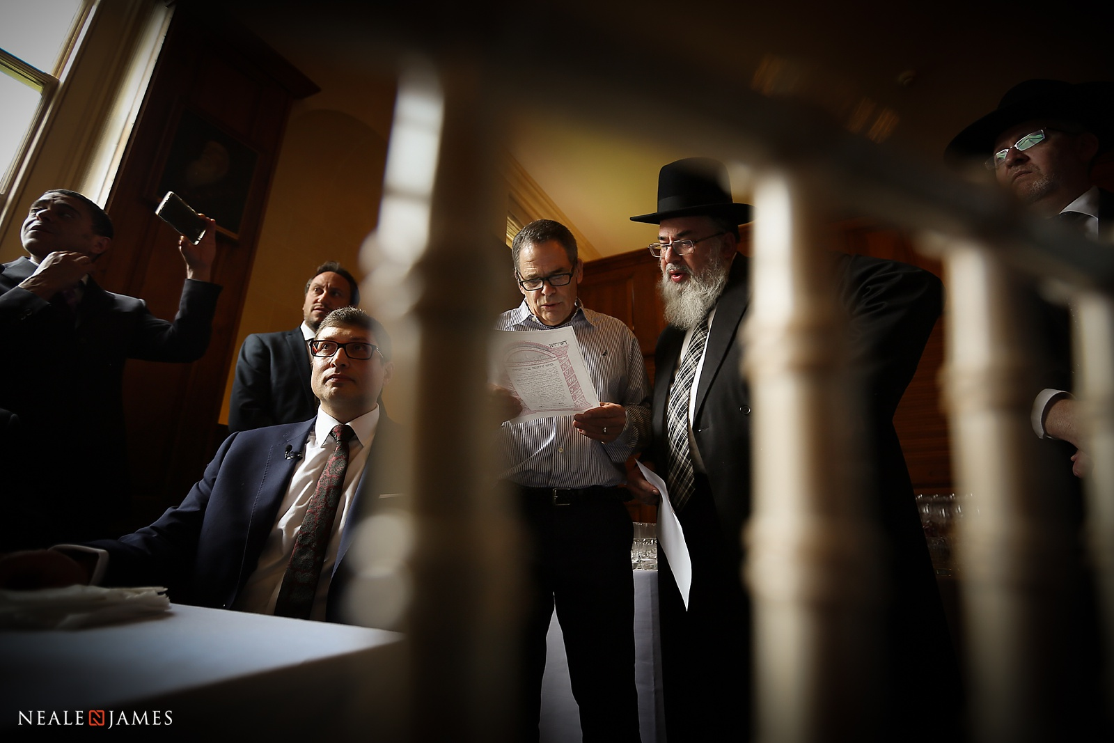 Reading the marriage contract at a Jewish wedding