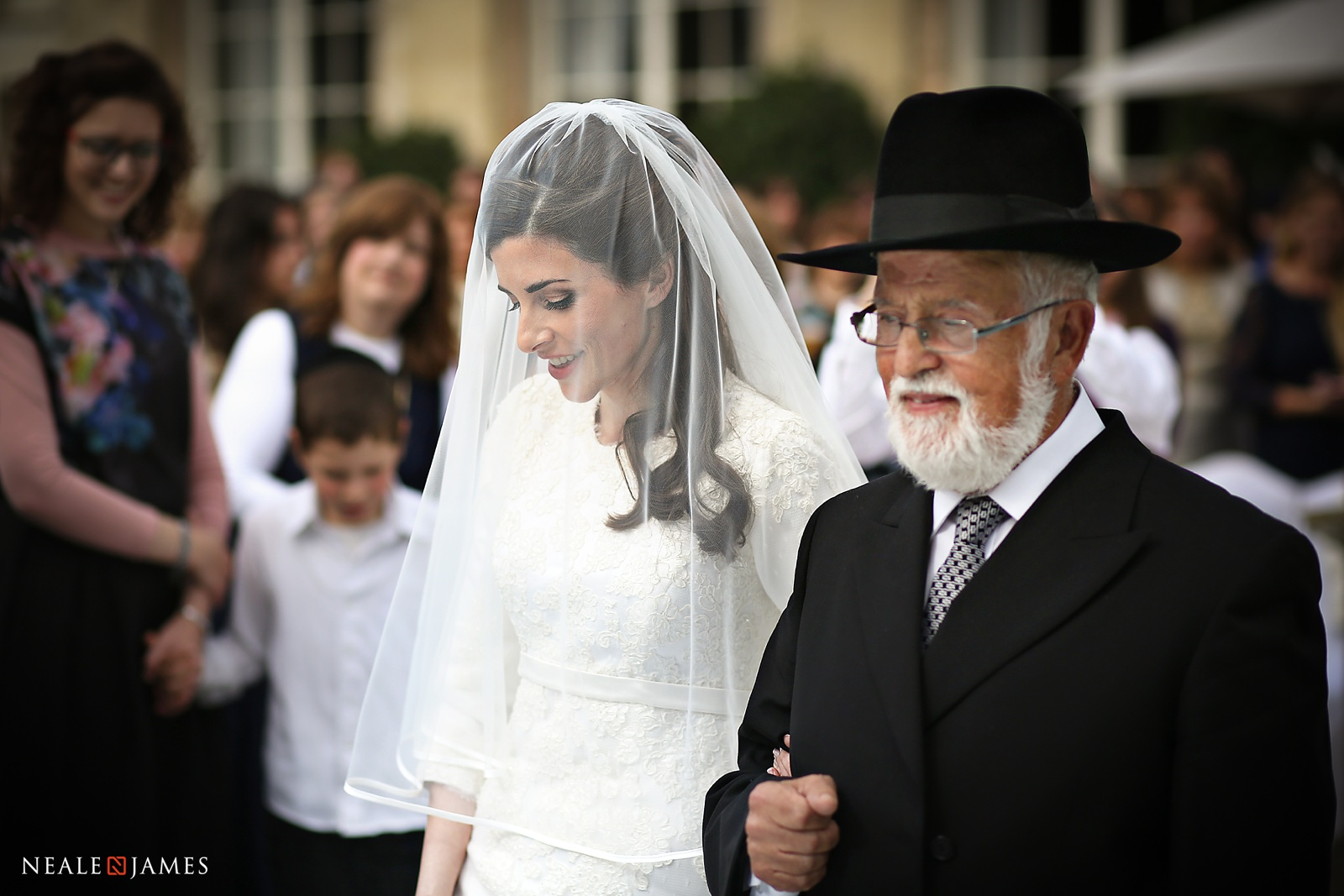 A father leads his daughter down the aisle at Woburn Abbey Sculpture Gallery