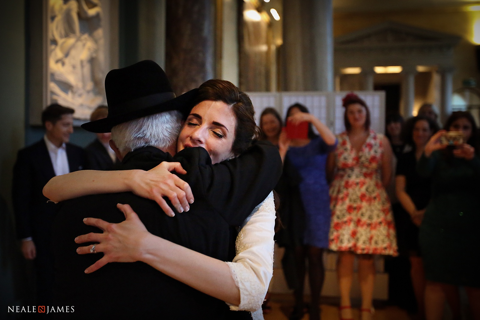 A bride embraces her father