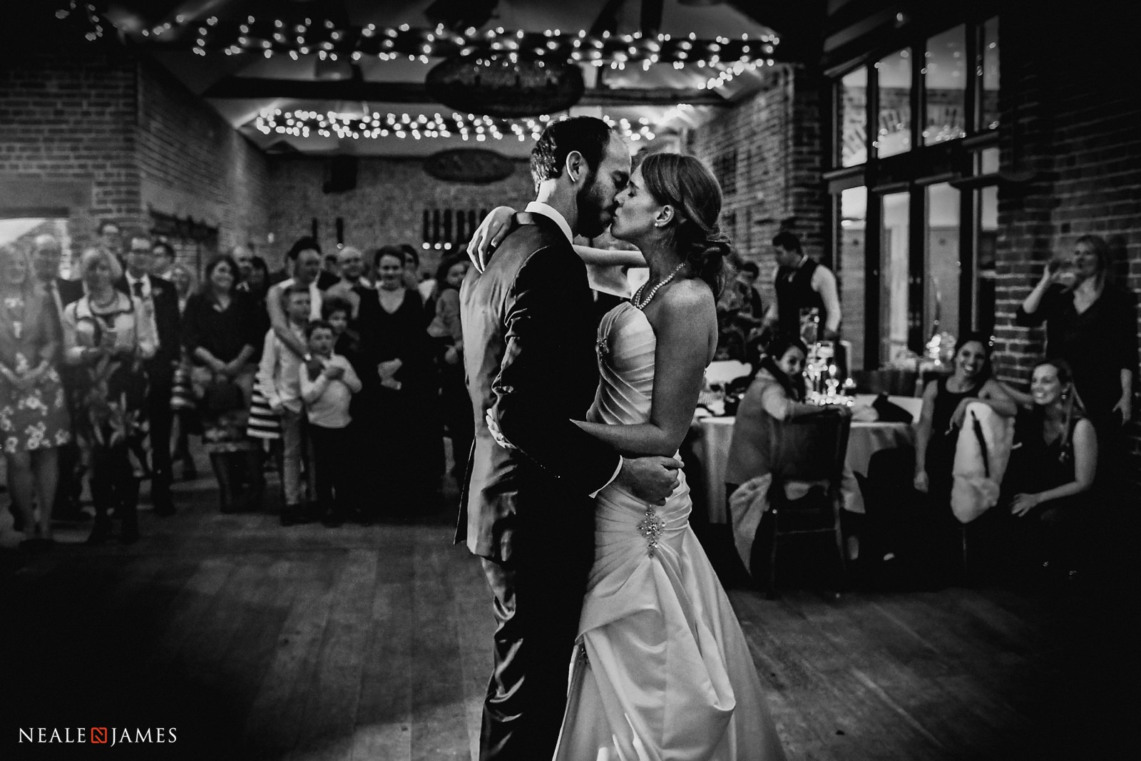 The bride and groom take to the dancefloor for their first dance at Wasing Park