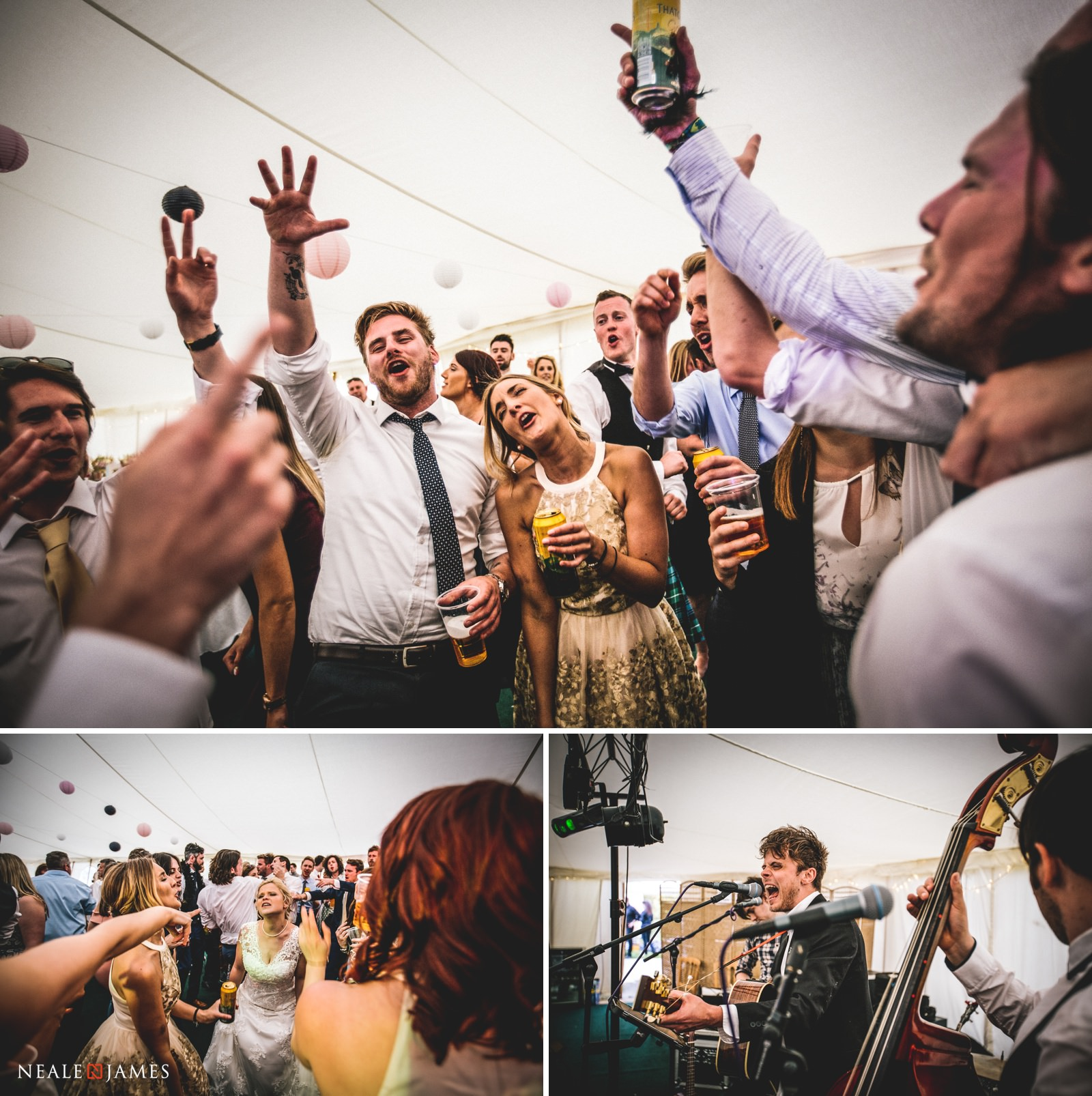 Guests enthusiastically partying with the wedding band at Gants Mill in Somerset