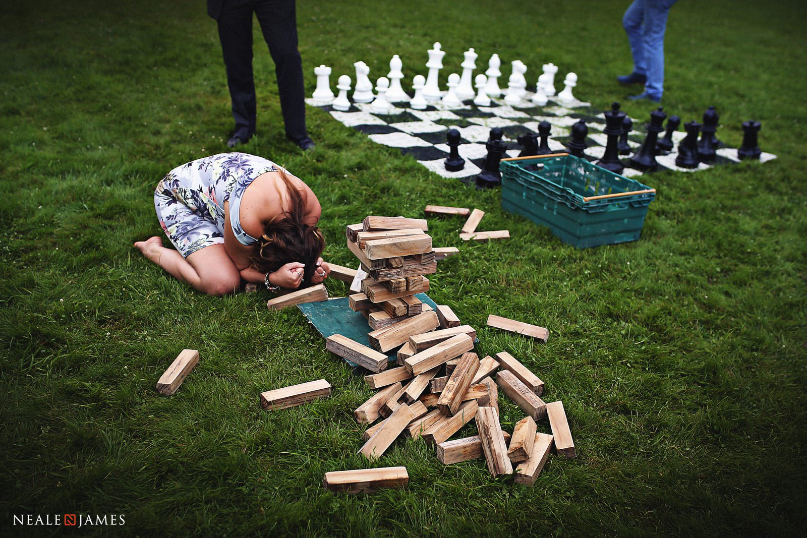 Colour photograph of Jenga being played at a wedding