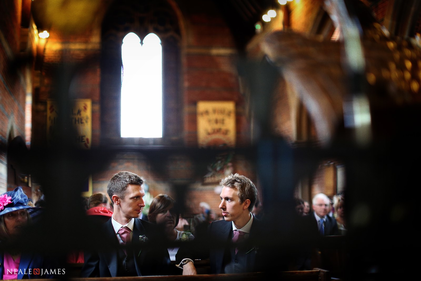 Colour photograph of groom and best man waiting for the bride in a Berkshire church