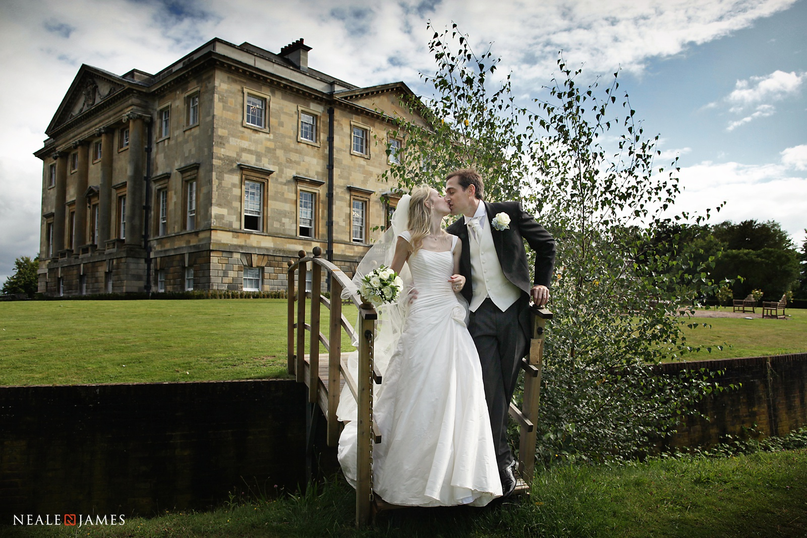 A couple in front of Botleys Mansion wedding venue
