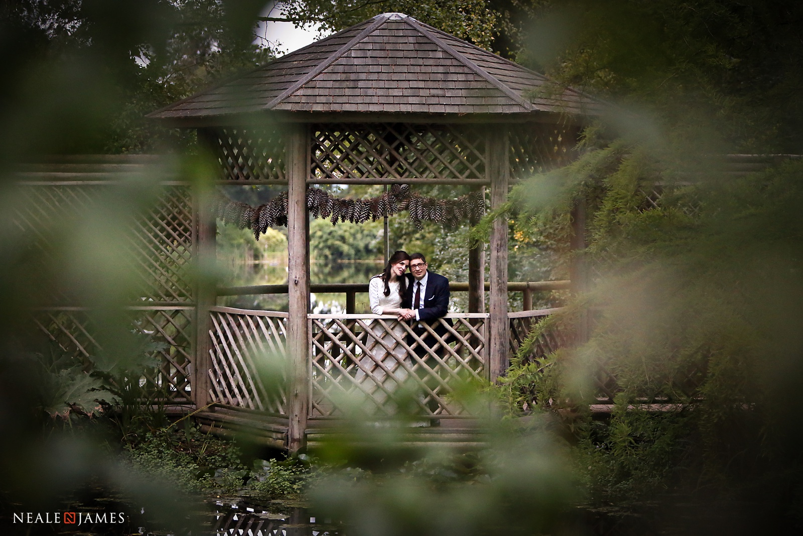 Photograph of a couple posing by a lake at Woburn Sculpture Park