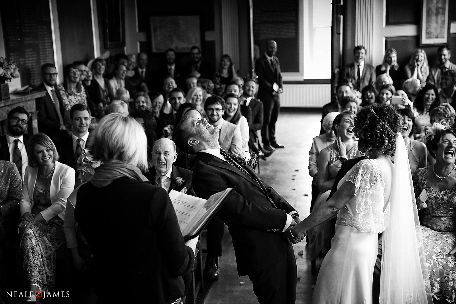Black and white picture of a couple celebrating their wedding day