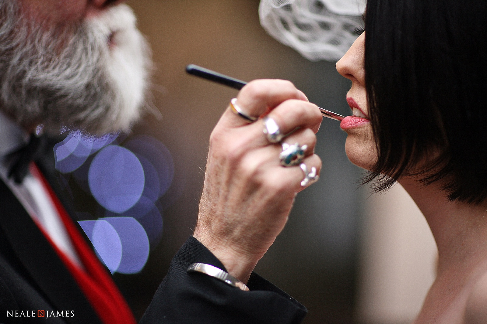 Make up being applied by a father on a bride's wedding day