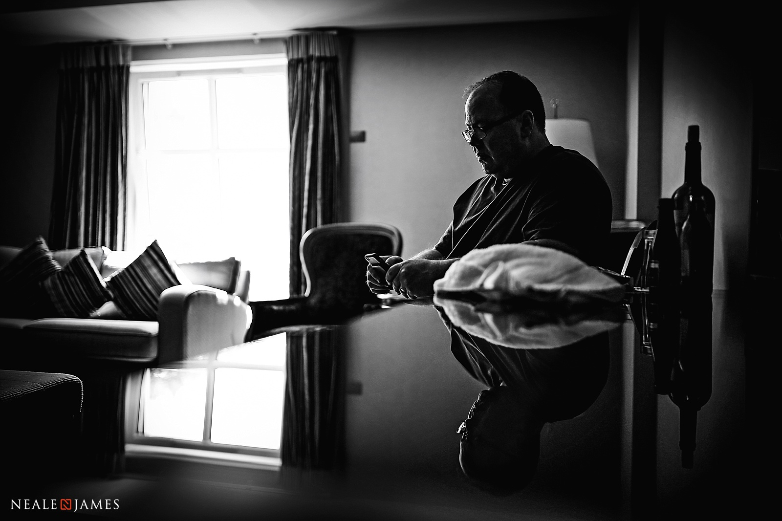 Black and white photograph with a lot of depth of a father practising his wedding speech