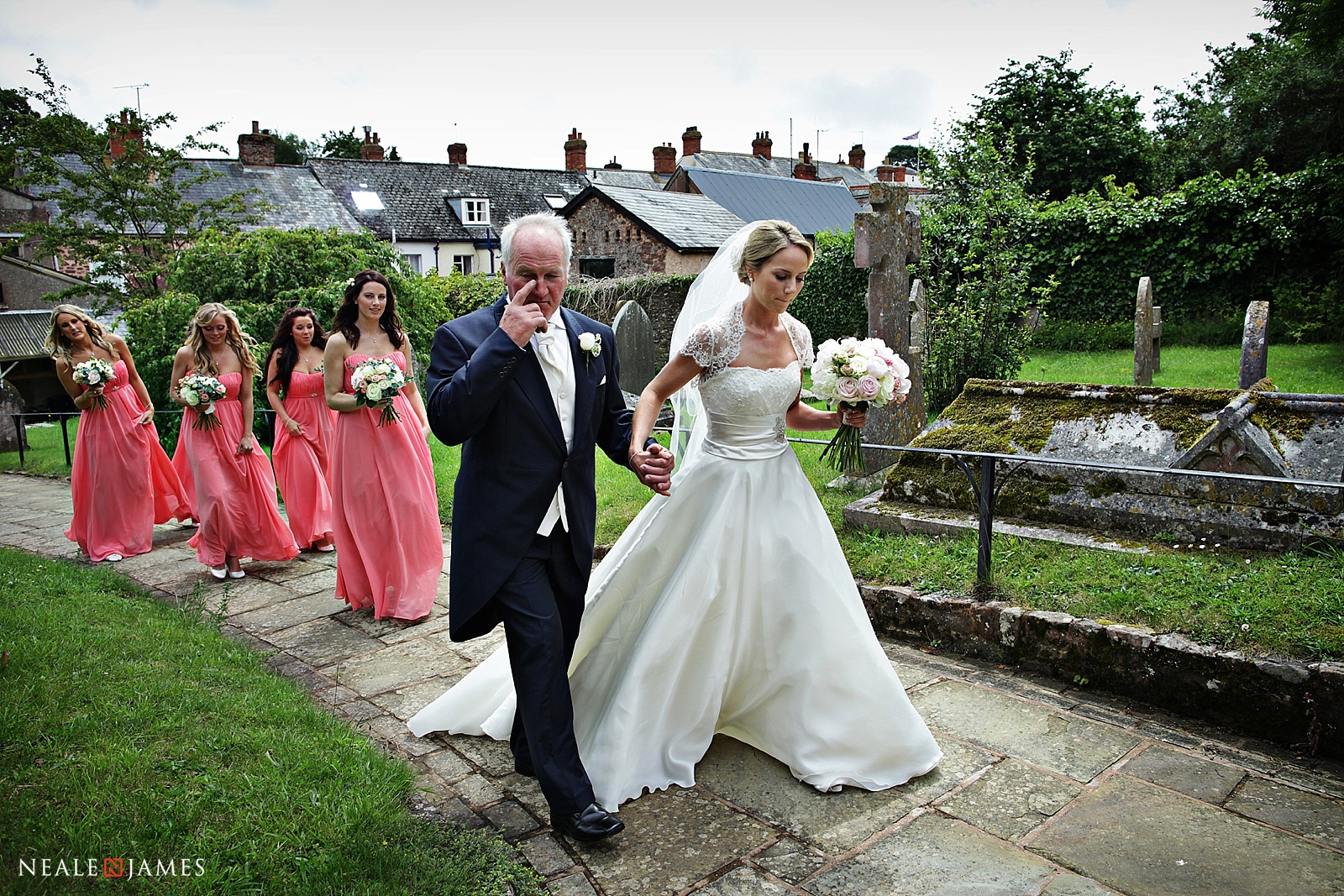 A bride and father walking to the wedding ceremony