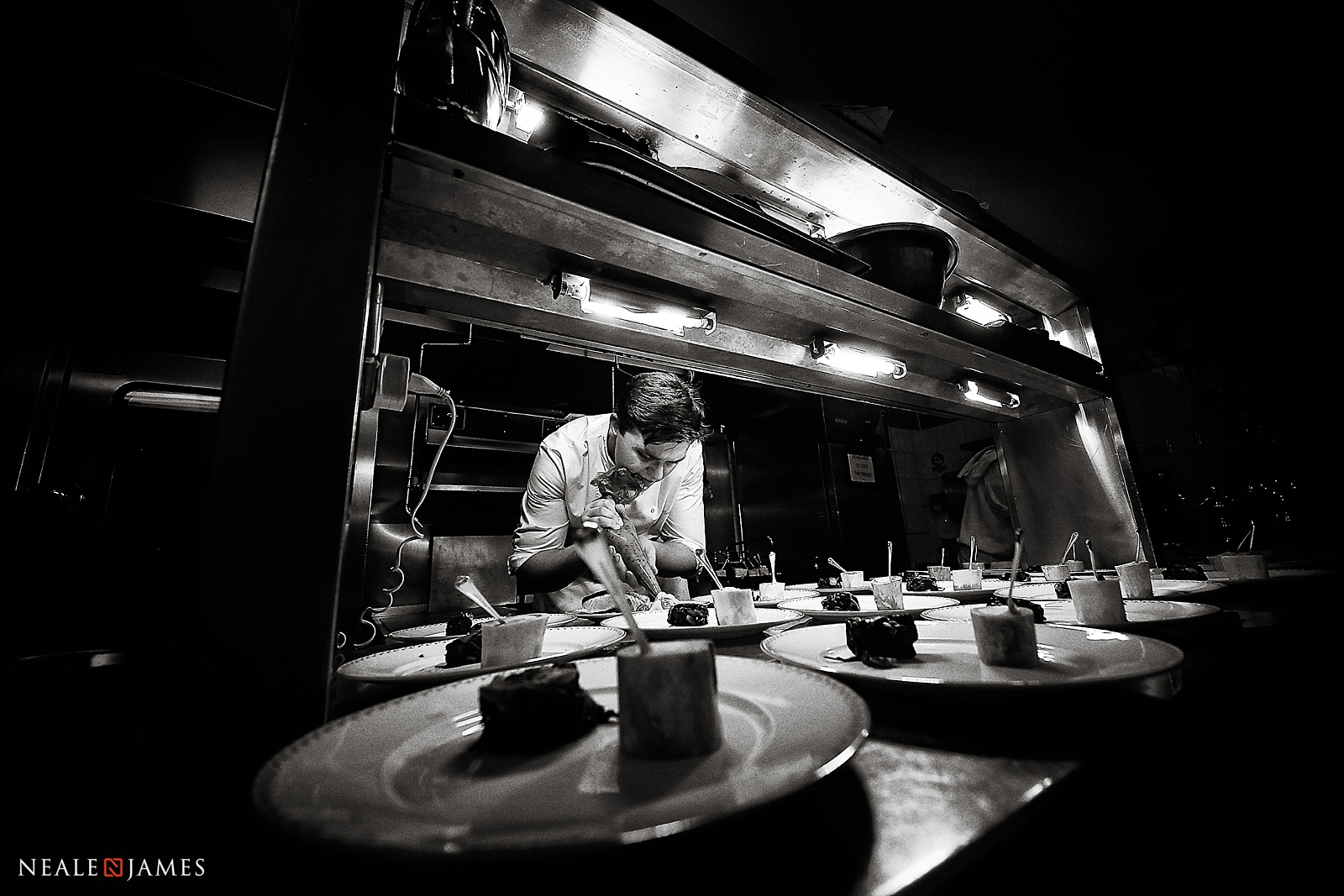 Black and white photo of a chef working at The Dorchester in London, at a wedding