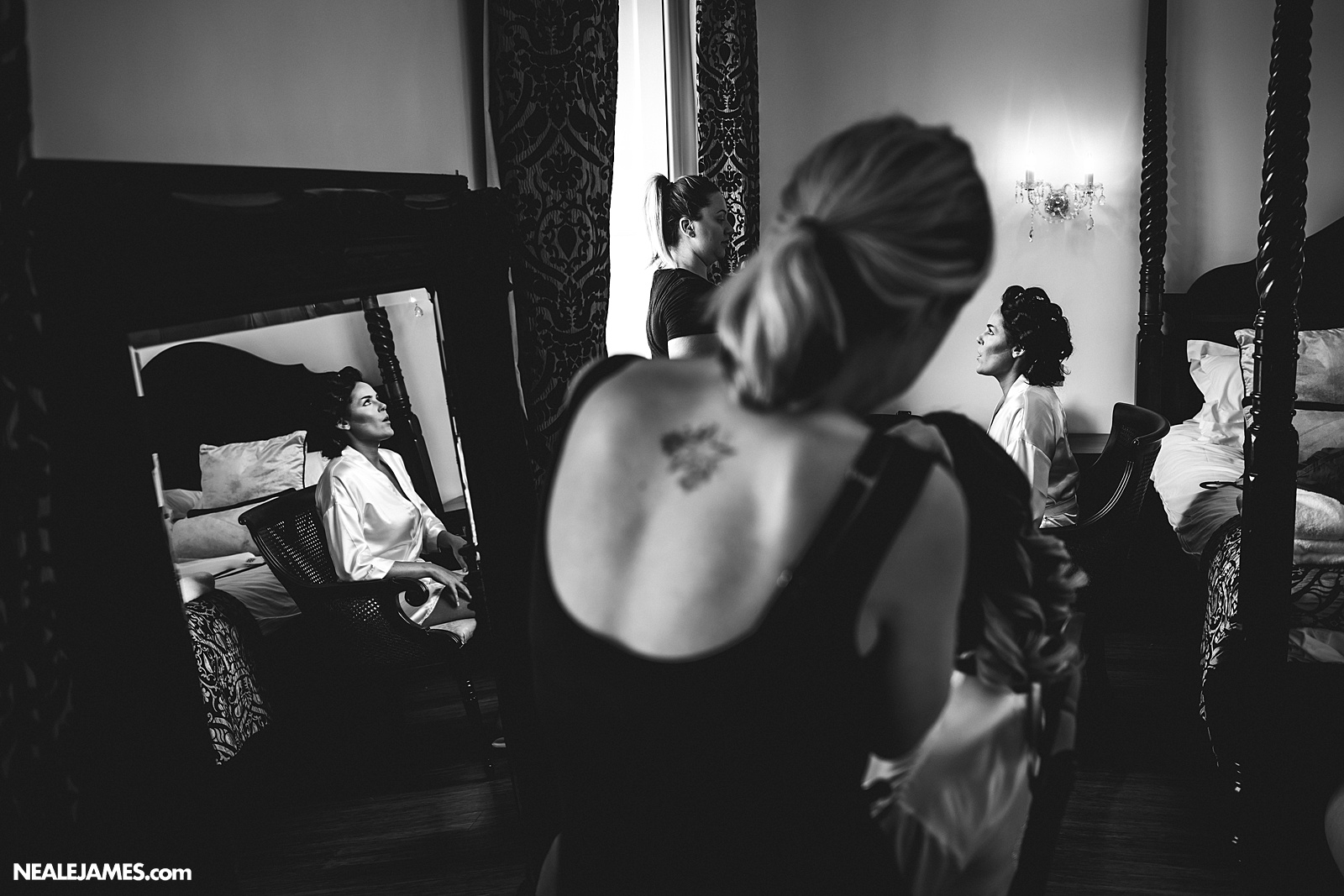 A black and white photograph captured at Botleys Mansion as the bride prepares for her wedding day