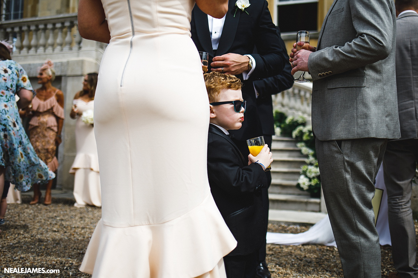 Colour photo of a child at wedding being cool