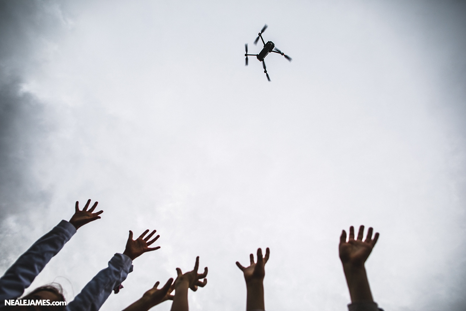 Colour photo of a drone above people at a wedding!