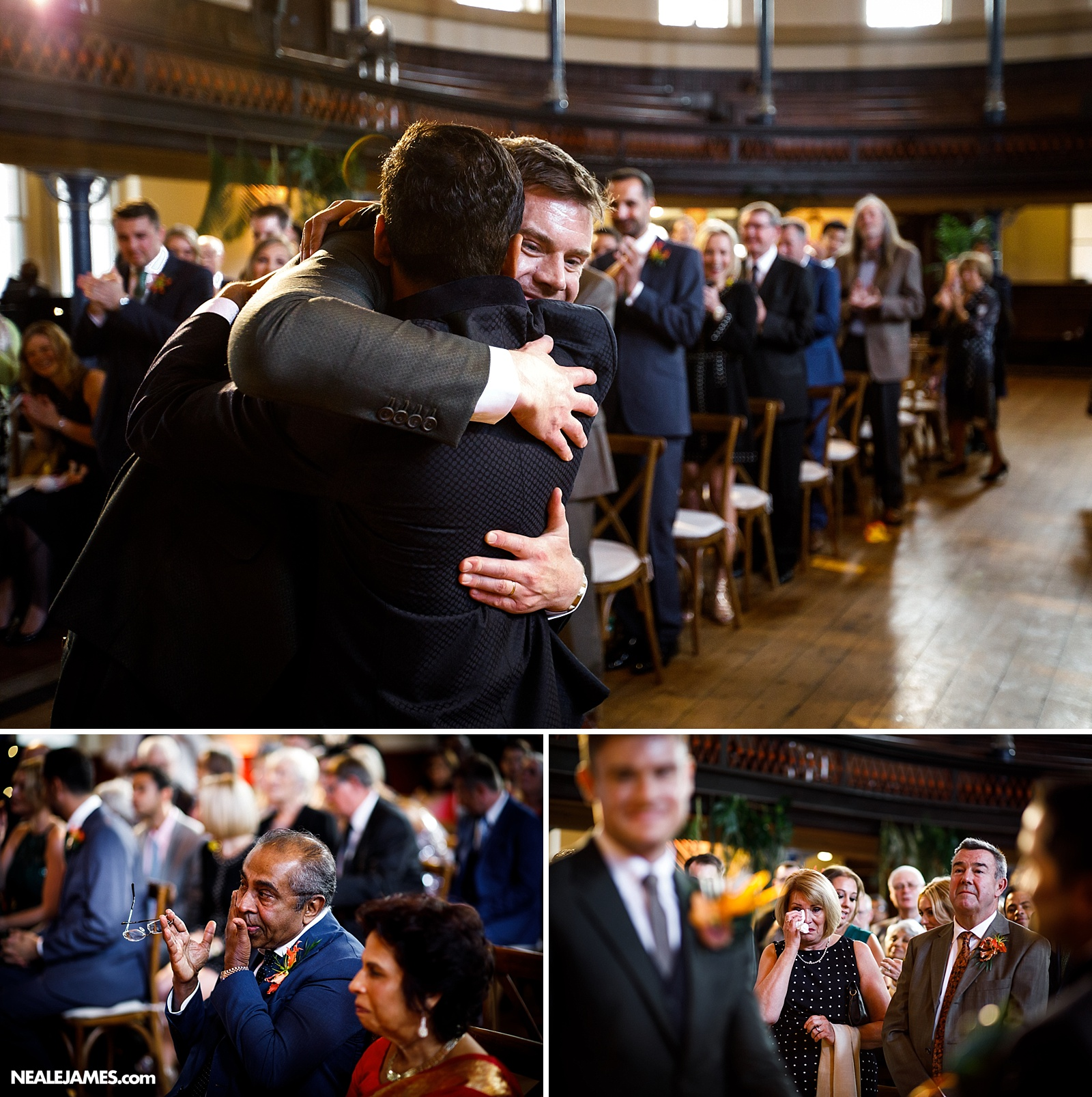 A husband embraces his husband at a wedding in London's Round Chapel