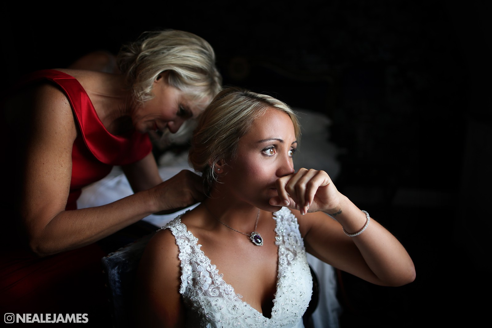 A colour picture of an emotional bride, just prior to the ceremony having make-up applied