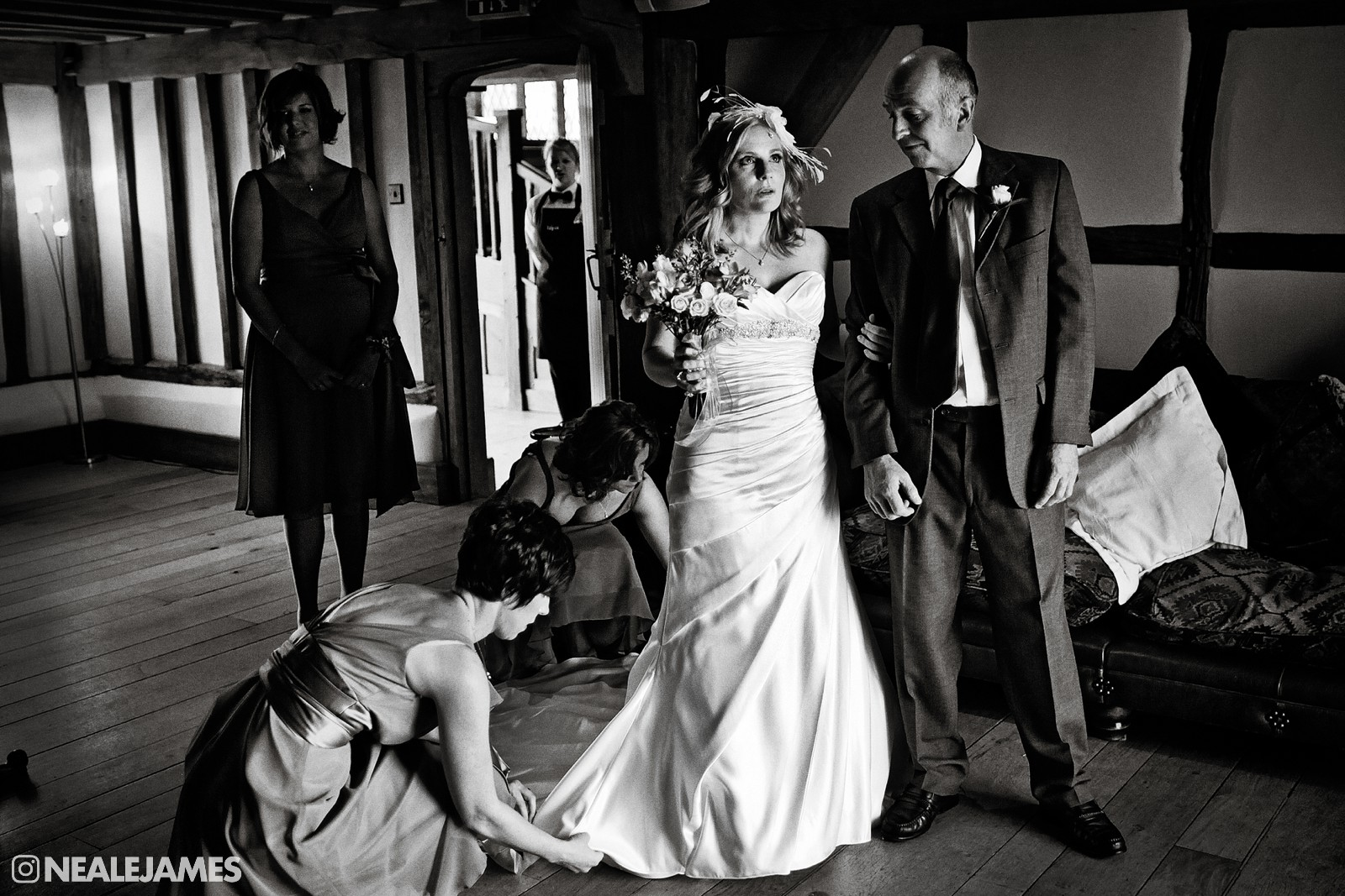 A black and white photo of a bride waiting for the wedding ceremony at Cain Manor