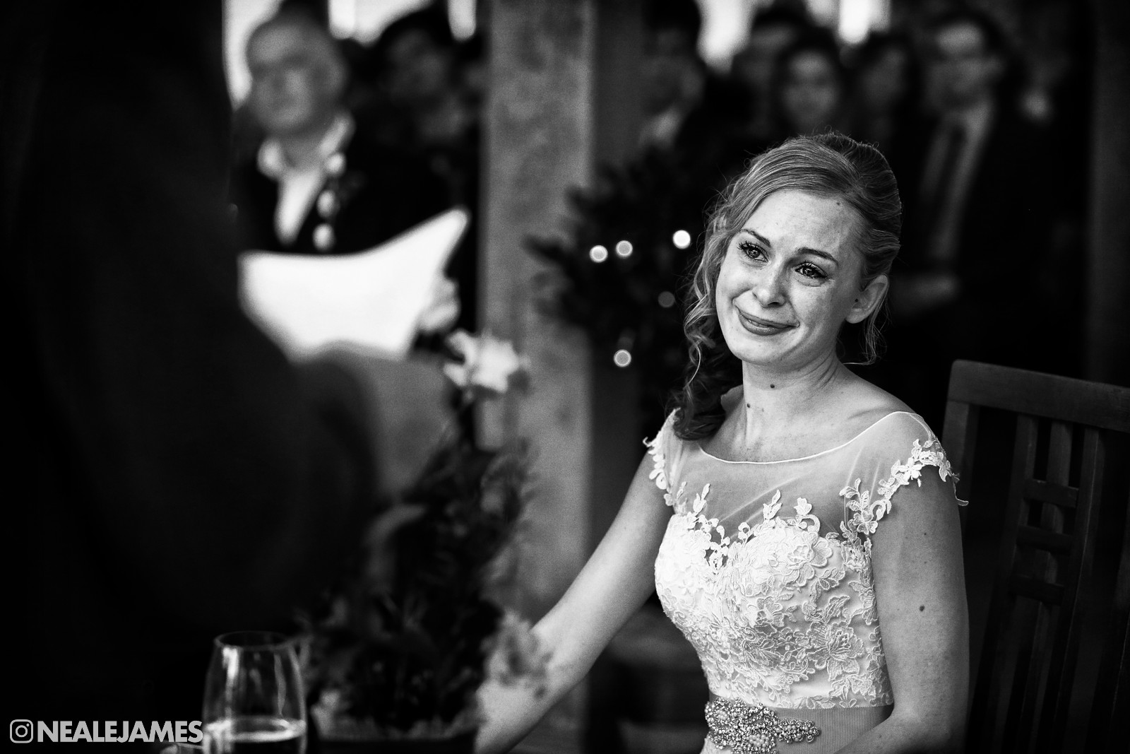 A black and white wedding picture of an emotional bride during her ceremony at Rivervale Barn Yateley