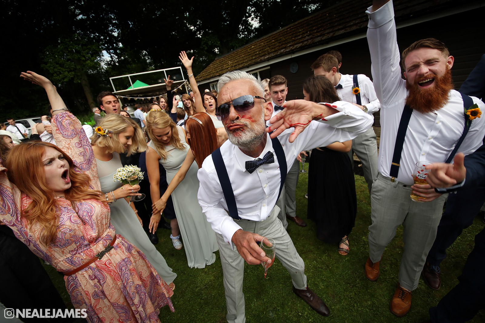A father of the groom in this colour picture partying with guests