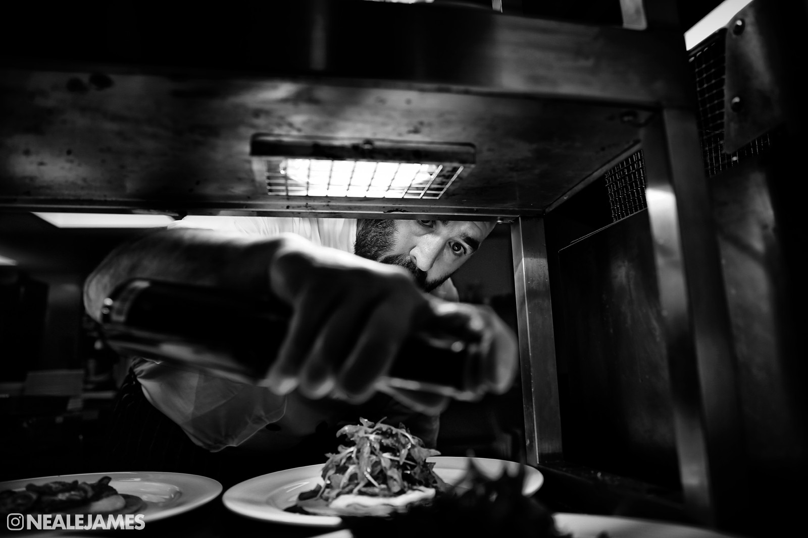 Black and white photo of the wedding chef at Wasing Park