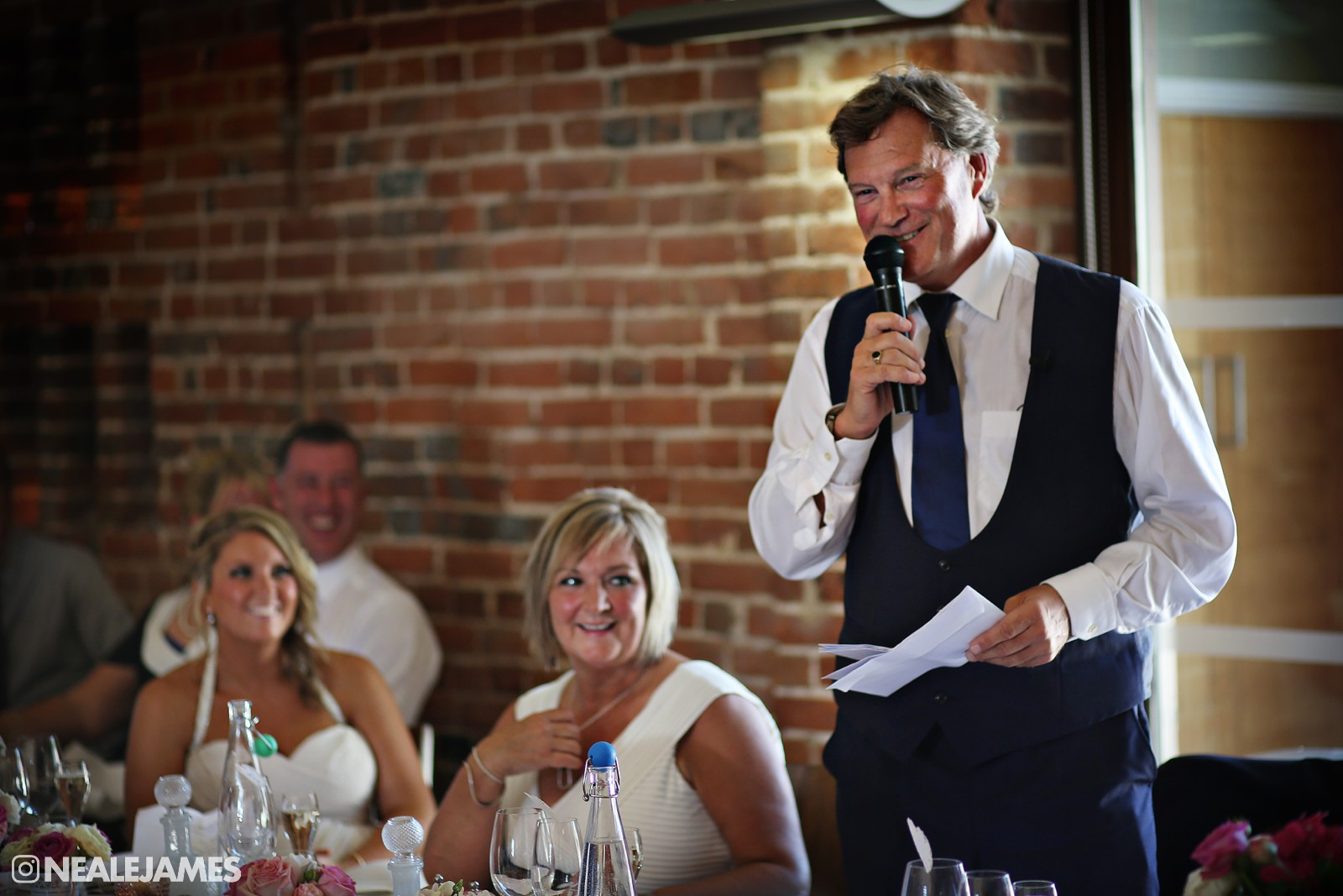 Colour picture of Glenn Hoddle making a speech at his daughter's wedding
