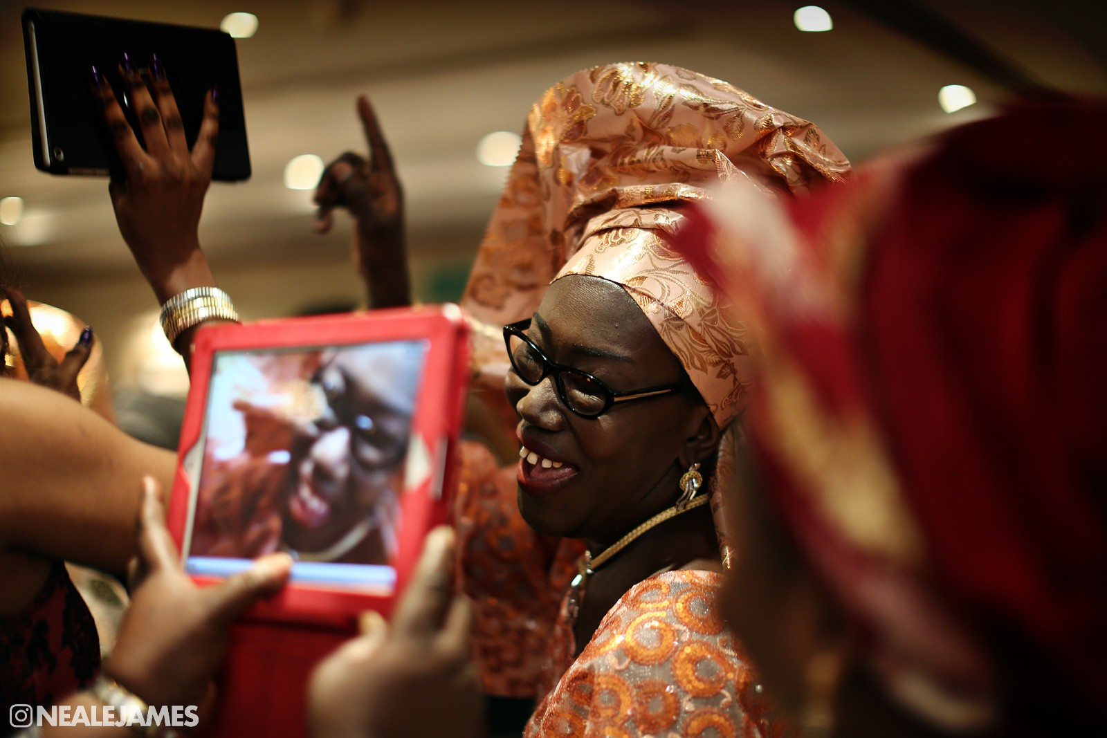 A colour photography of the party getting underway at this British Nigerian wedding