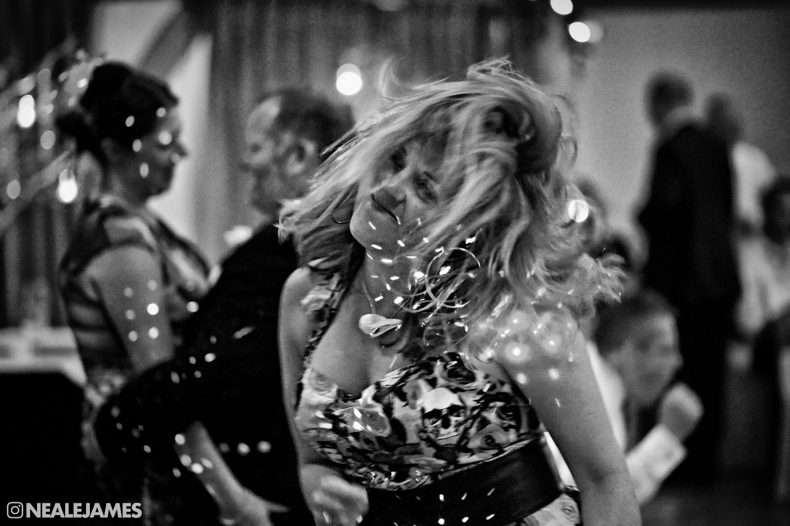 Black and white picture of a guest really dancing hard