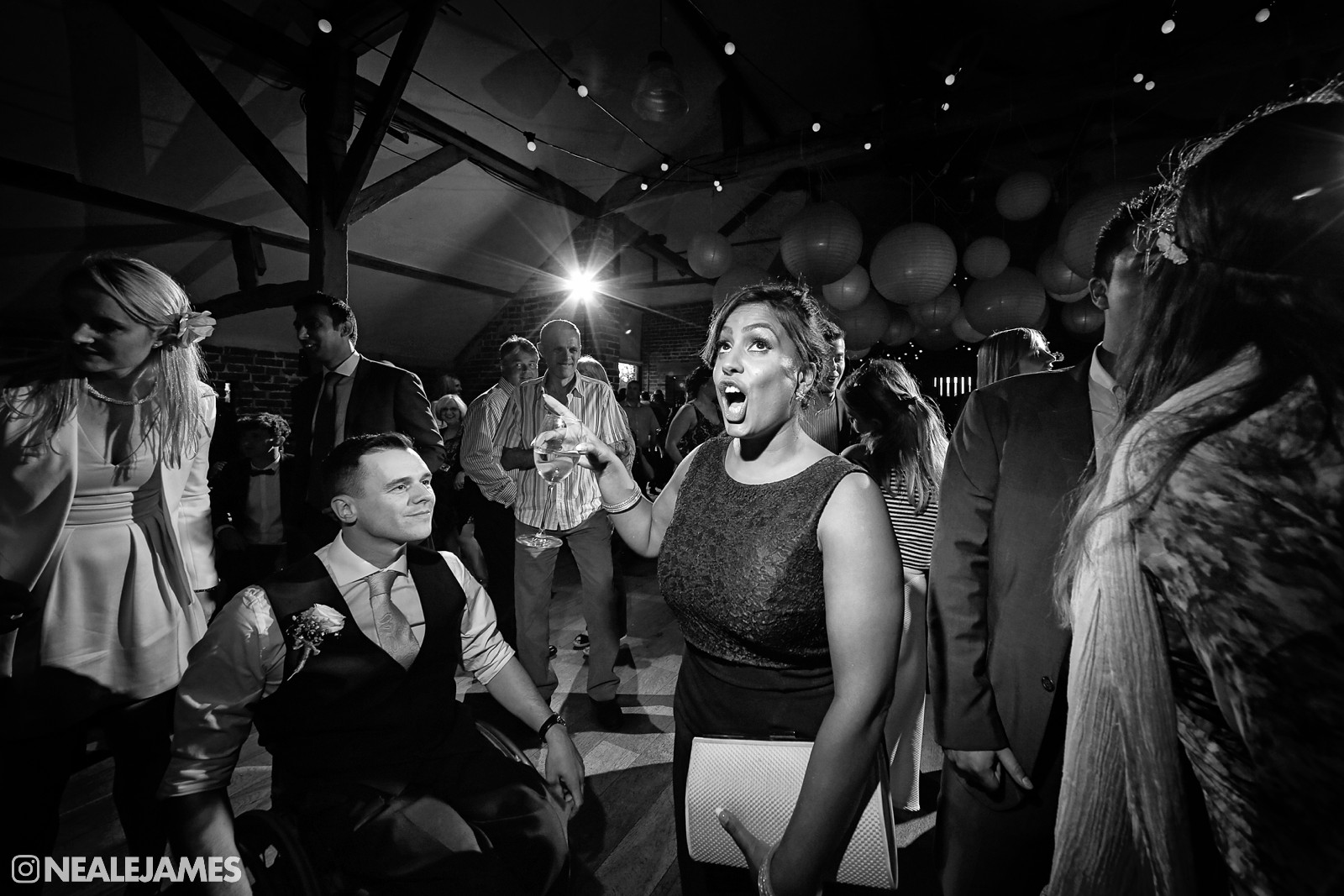 Black and white picture of guests dancing at a Wasing Park wedding event