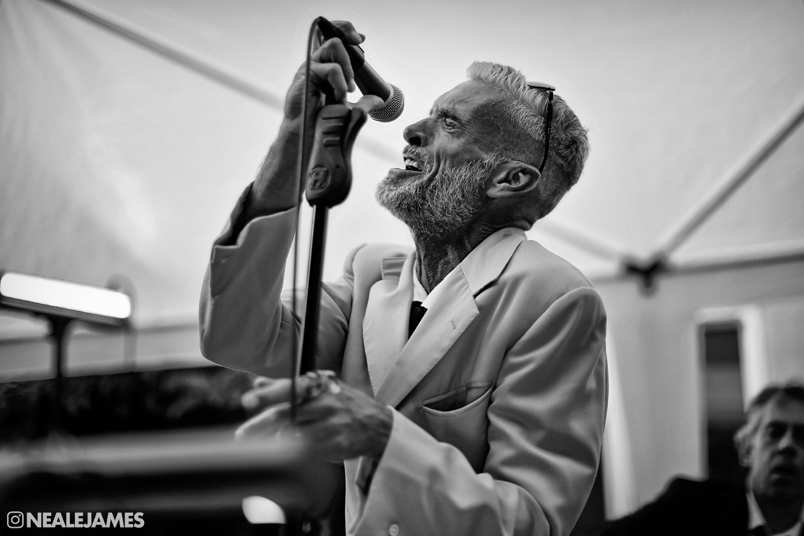 A black and white picture of a father singing a tune at his daughter's wedding