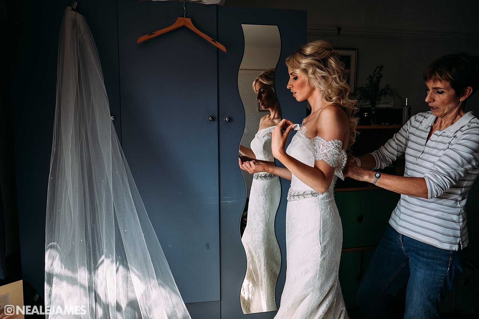 Picture of a bride wearing her wedding dress for the first time