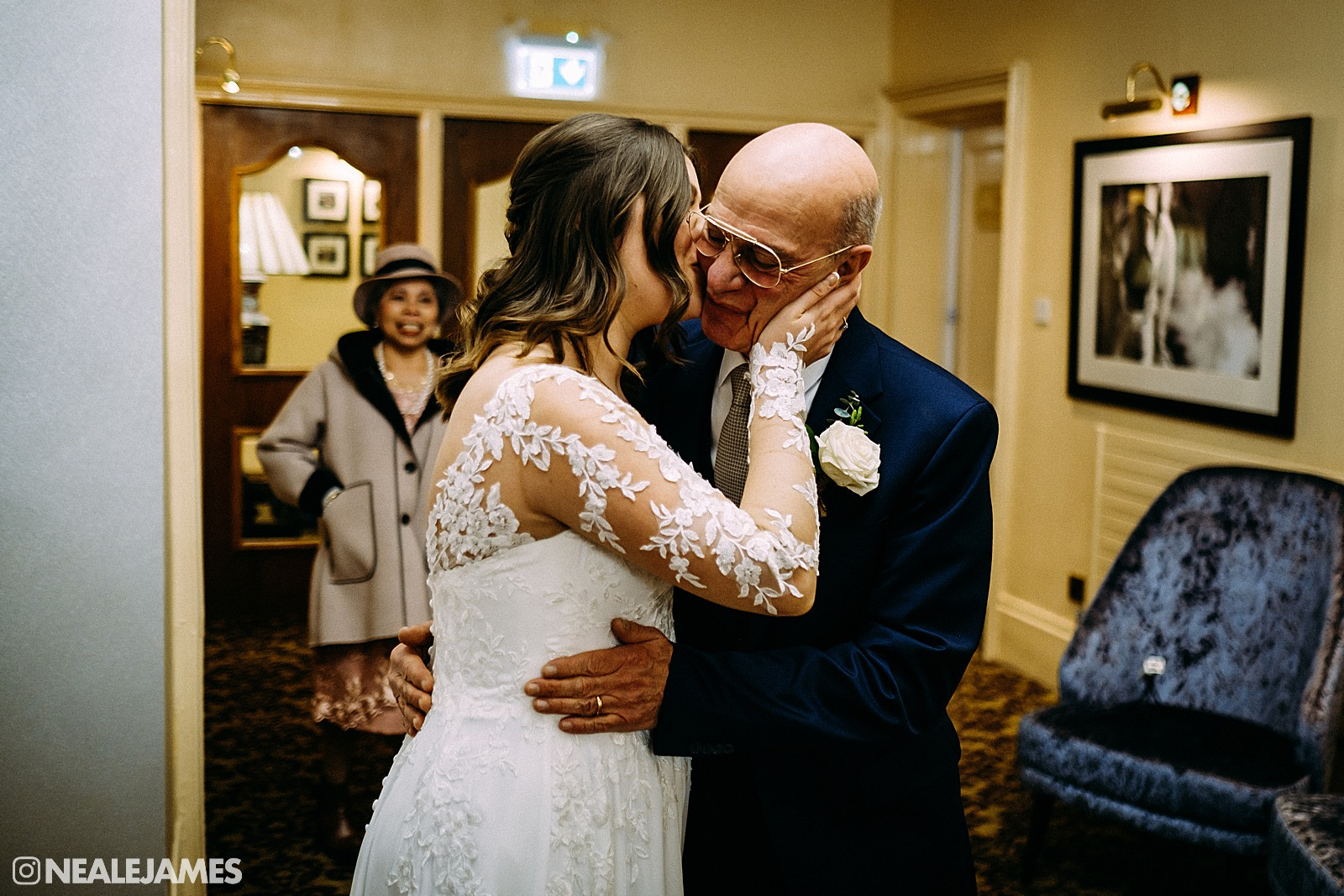 A colour picture of a bride embracing her father