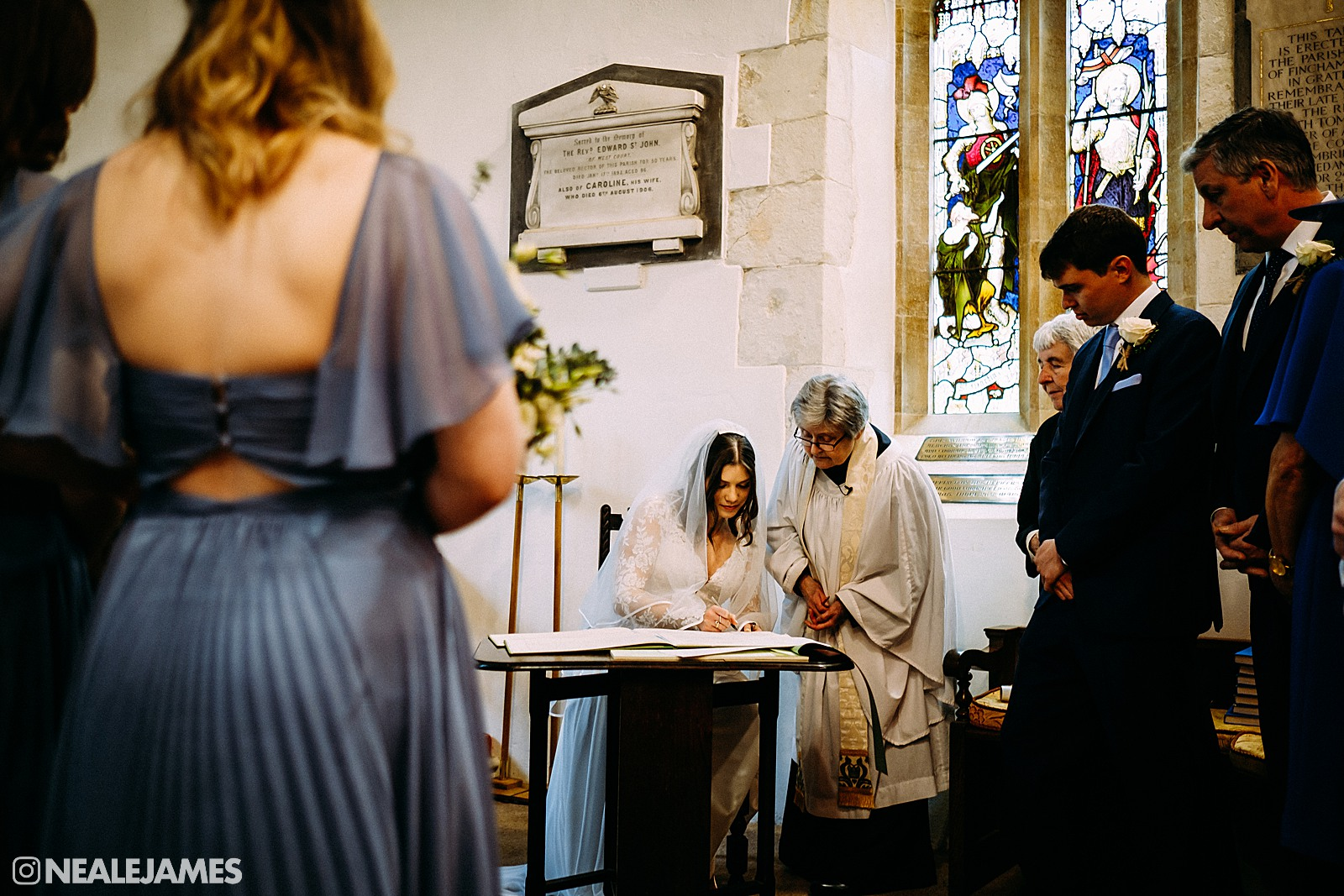A bride signing the register in church