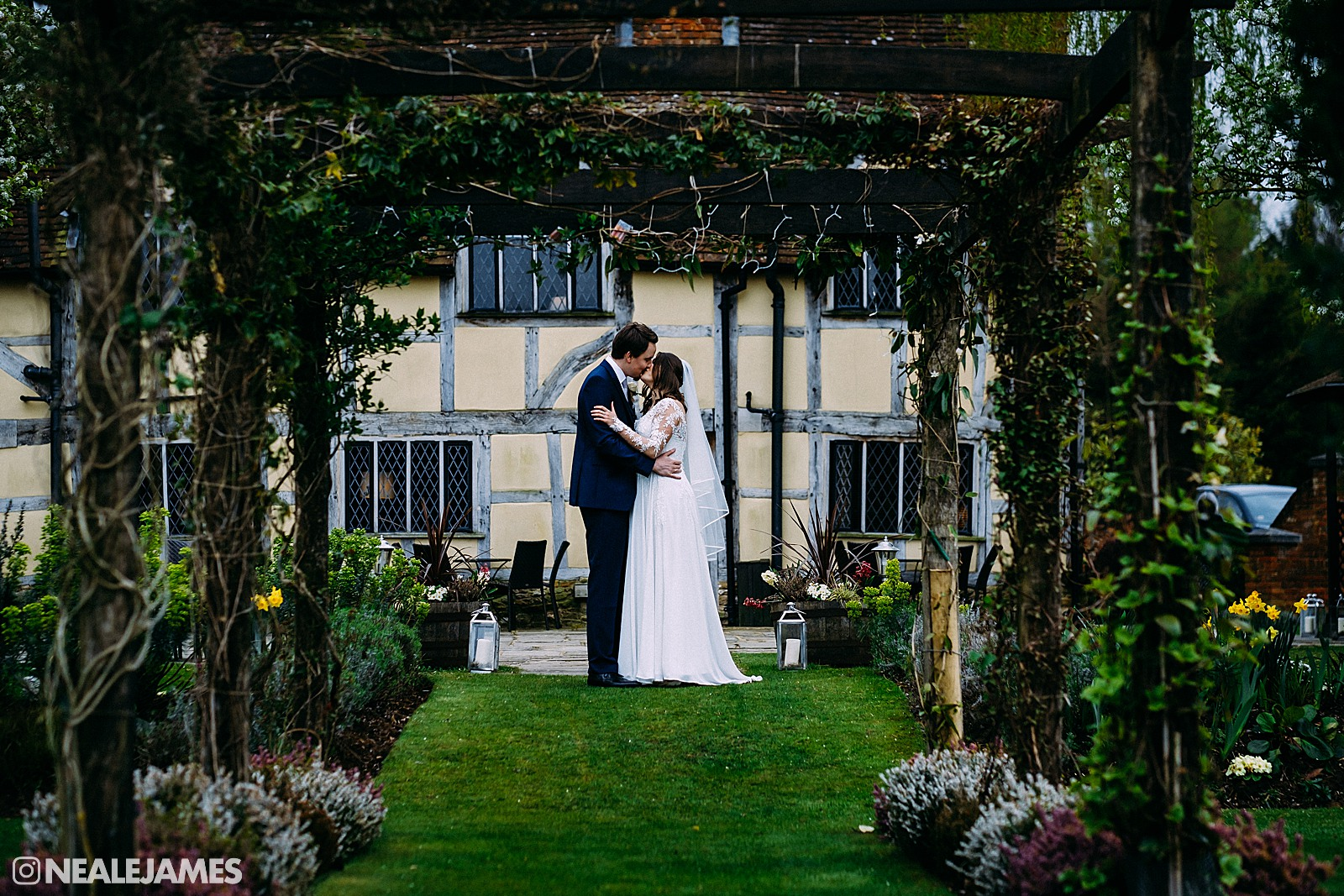 A bride and groom at Cain Manor kissing