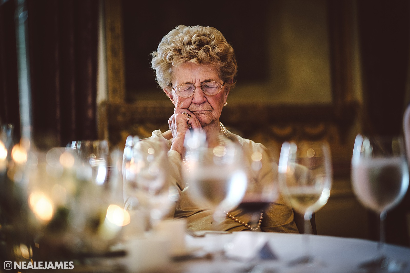 Colour photo of a grandmother who has fallen asleep during a wedding speech