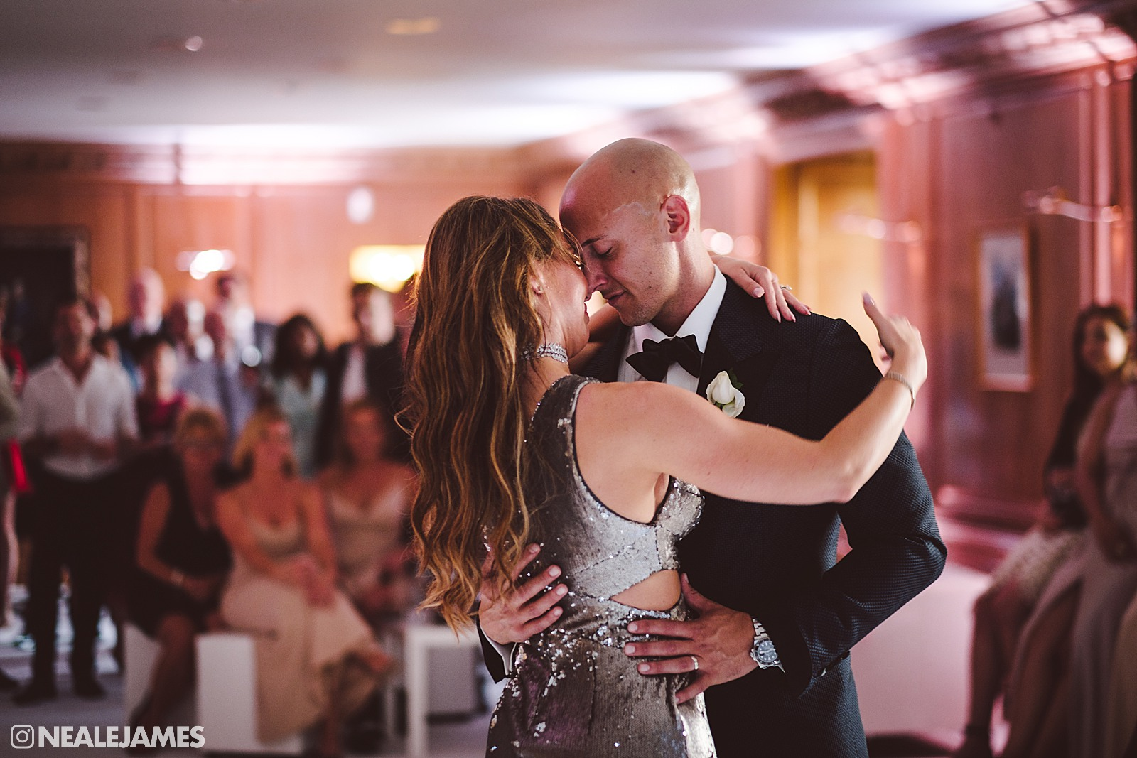 A bride and groom have their first dance at Brocket Hall wedding