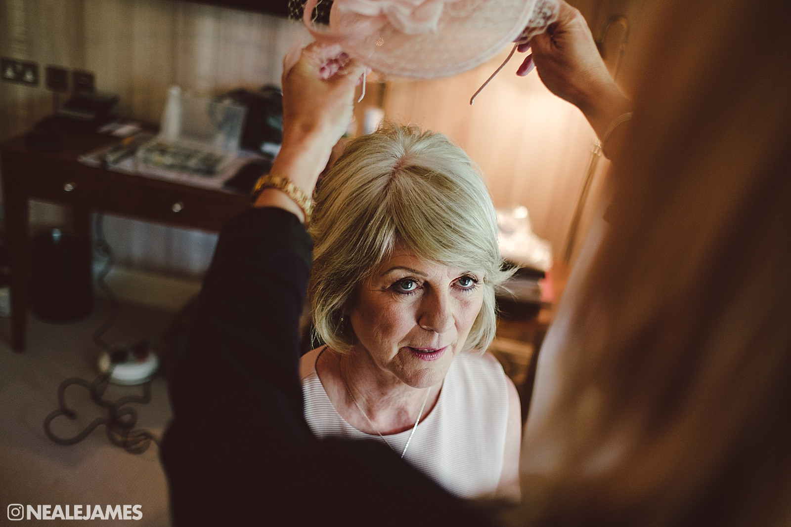 A mother being made up for her daughter's Vineyard wedding